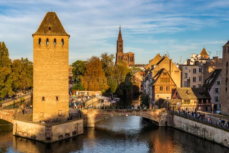 Strasbourg cityscape of the historic medieval district La Petite France with the cathedral in the background.. Scenic and iconic stock photos