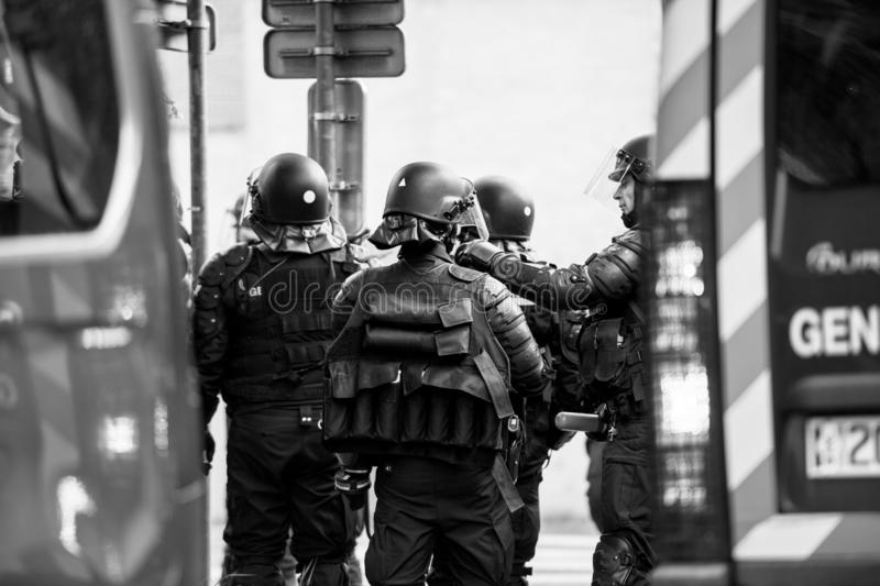 Rear view of French police officers gendarmes at yellow vests protest. Strasbourg, France - Apr 28, 2019: Black and white image of four French police officers royalty free stock photos