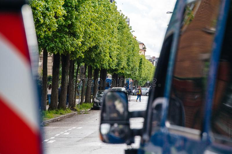 Police vans secruing street during yellow vests protest. Strasbourg, France - Apr 28, 2019: police vans secruing entrance to Rue Rene Schickele after stock photos