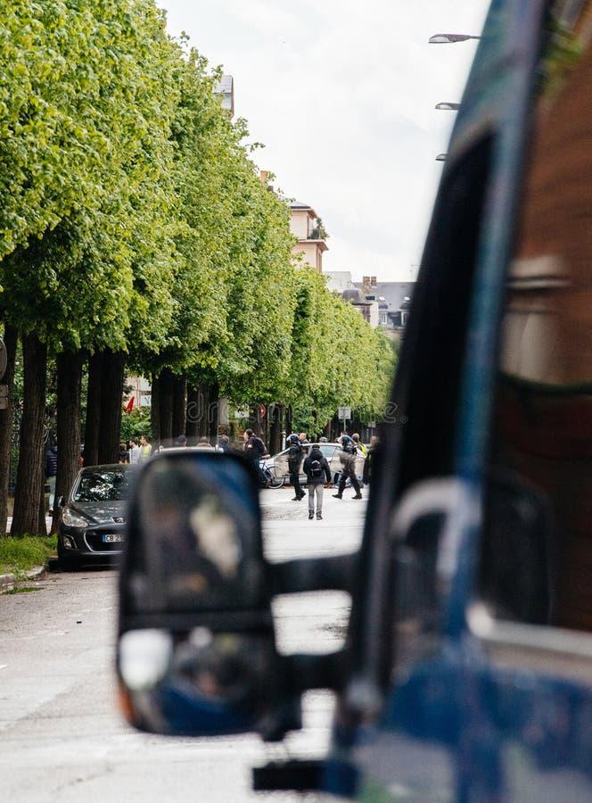 Police vans secruing street during yellow vests protest. Strasbourg, France - Apr 28, 2019: police vans secruing entrance to Rue Rene Schickele after stock images