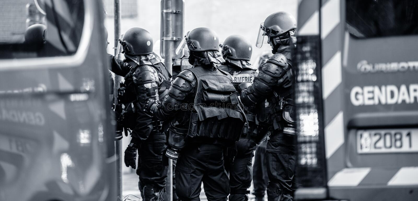 Rear view of French police officers gendarmes at yellow vests protest. Strasbourg, France - Apr 28, 2019: Rear view of French police officers gendarmes near stock photography