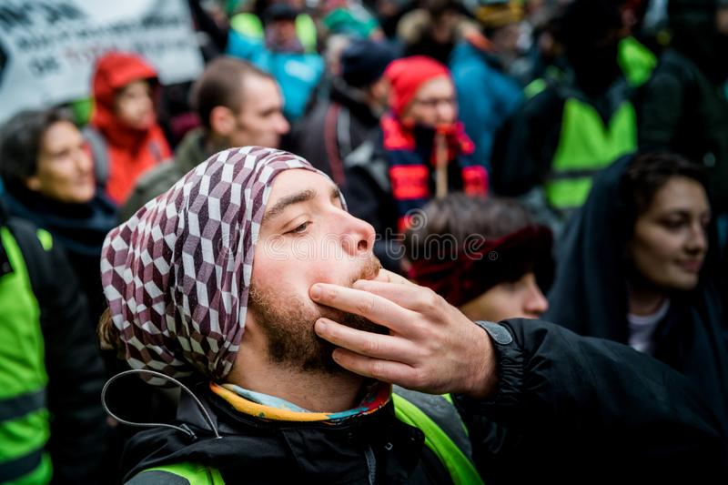 Whistling at Marche Pour Le Climat march protest on French stree royalty free stock photography