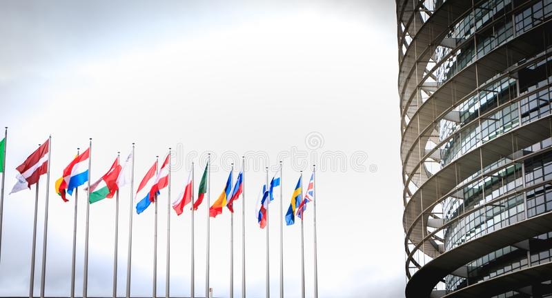 Set of european flags in front of the european parliament royalty free stock image
