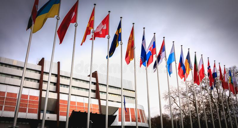 Set of European flags in the wind in front of the Council of Europe stock photography