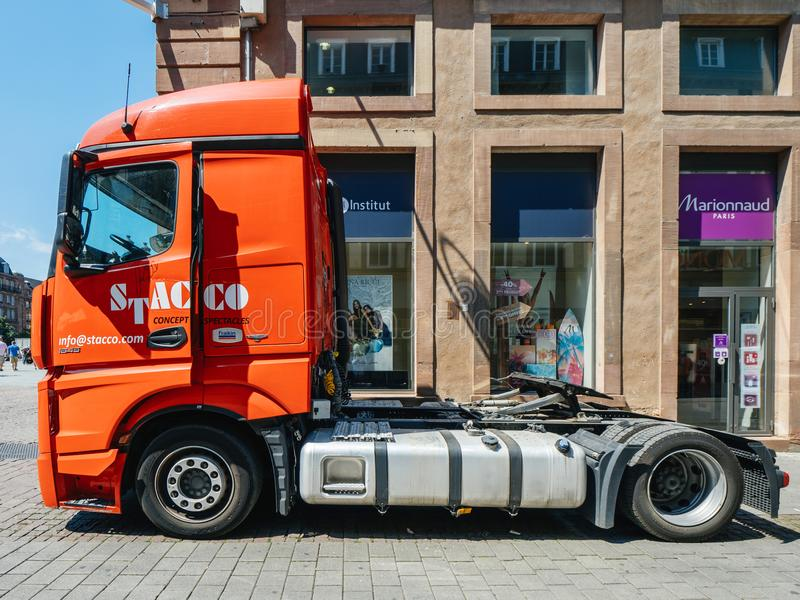 REd Mercedes Benz Actros truck parked in City stock image