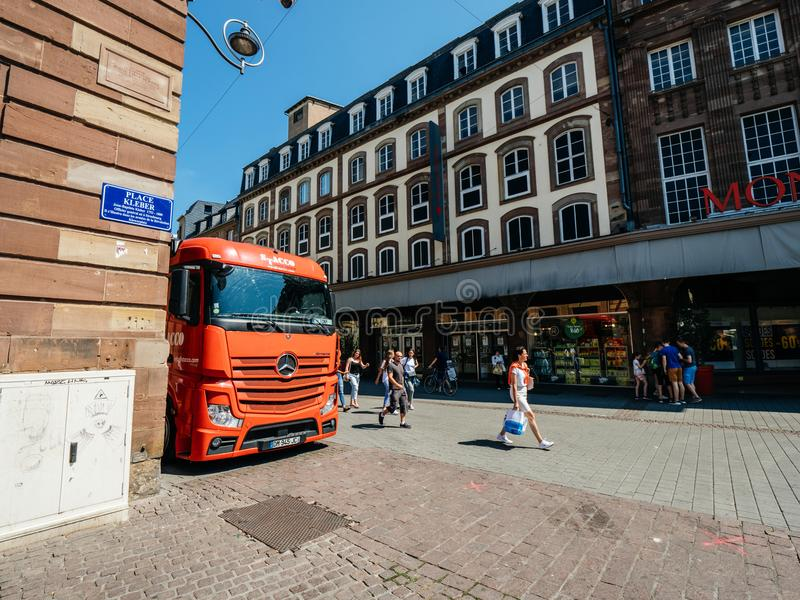REd Mercedes Benz Actros truck parked in City stock images