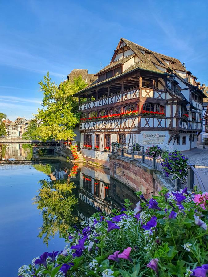 STRASBOURG, FRANCE - June 2019: traditional half timbered houses of Petite France along the picturesque canals stock photography