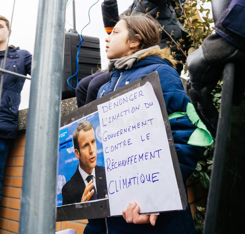 Global movement Fridays for Future police protesters placards government. STRASBOURG, FRANCE - MAR 15, 2019: Young french girl with placard portrait of Emmanuel stock photography