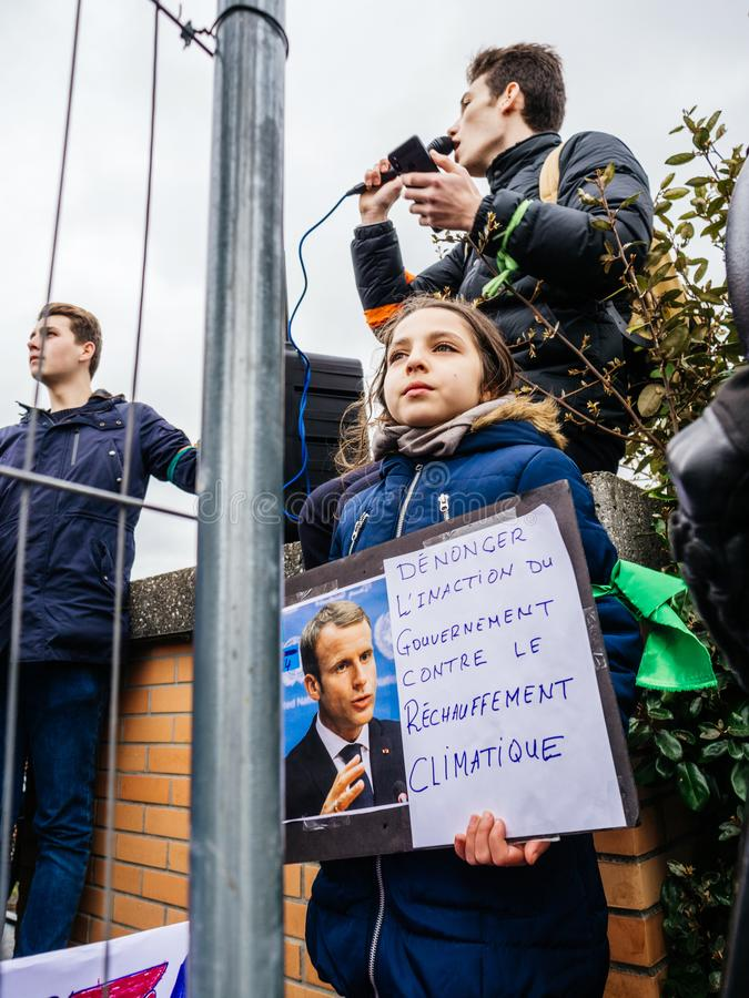Global movement Fridays for Future police protesters placards government. STRASBOURG, FRANCE - MAR 15, 2019: Young french girl with placard portrait of Emmanuel royalty free stock photos
