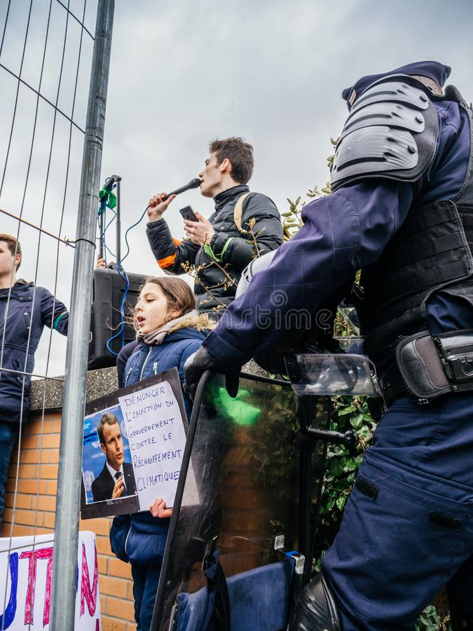 Global movement Fridays for Future police protesters placards government. STRASBOURG, FRANCE - MAR 15, 2019: Young french girl with placard portrait of Emmanuel stock photo