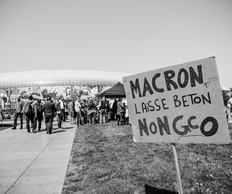 Fete a Macron. STRASBOURG, FRANCE - MAY 5, 2018: People making a party protest Fete a Macron party for Macron in front of Gare de Strasbourg againt grand royalty free stock image