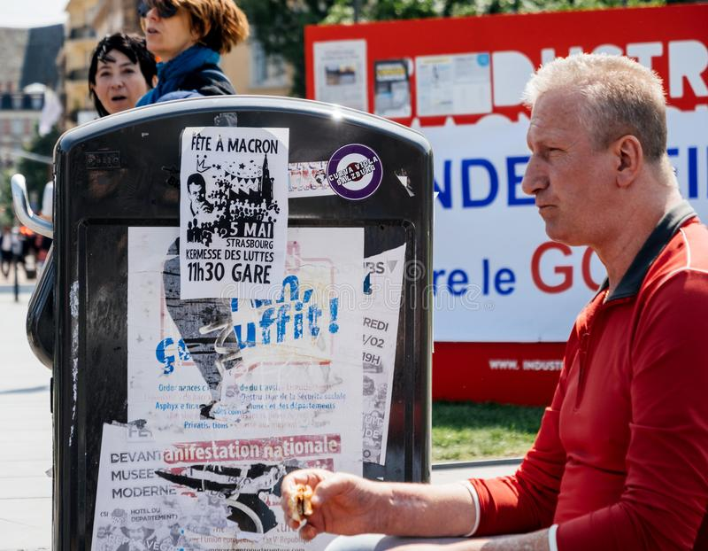 Fete a Macron. STRASBOURG, FRANCE - MAY 5, 2018: People making a party protest Fete a Macron party for Macron in front of Gare de Strasbourg - man eating near stock photo