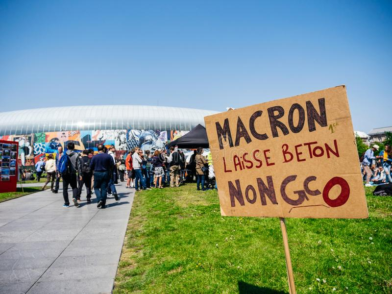Fete a Macron. STRASBOURG, FRANCE - MAY 5, 2018: People making a party protest Fete a Macron party for Macron in front of Gare de Strasbourg againt grand stock images