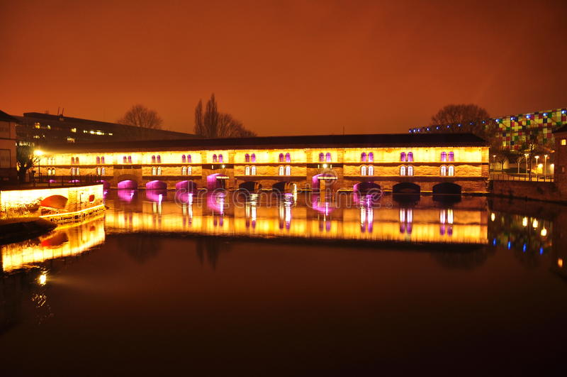 Strasbourg, France. Night view of the barrage Vauban. The illuminated bridge of barrage Vauban, Strasburg, France. Night view royalty free stock photos