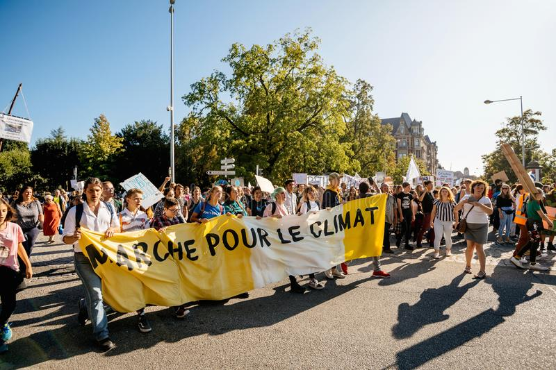 People rally for action on climate change yellow placard stock images