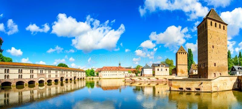 Strasbourg, towers of medieval bridge Ponts Couverts. Alsace, France. Strasbourg, towers of medieval bridge Ponts Couverts and reflection, Barrage Vauban royalty free stock photos
