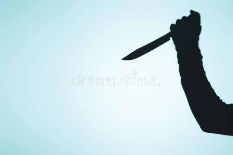 straszny cień osoby mienia nóż w ręce royalty ilustracja