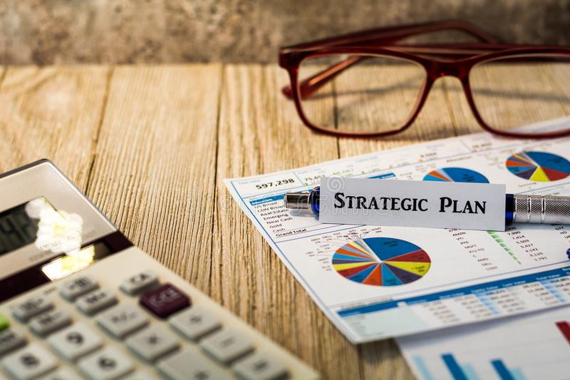 Strategic Plan financial strategy motivational concept. Strategic Plan business motivational concept with charts and graphs on wooden board royalty free stock photo