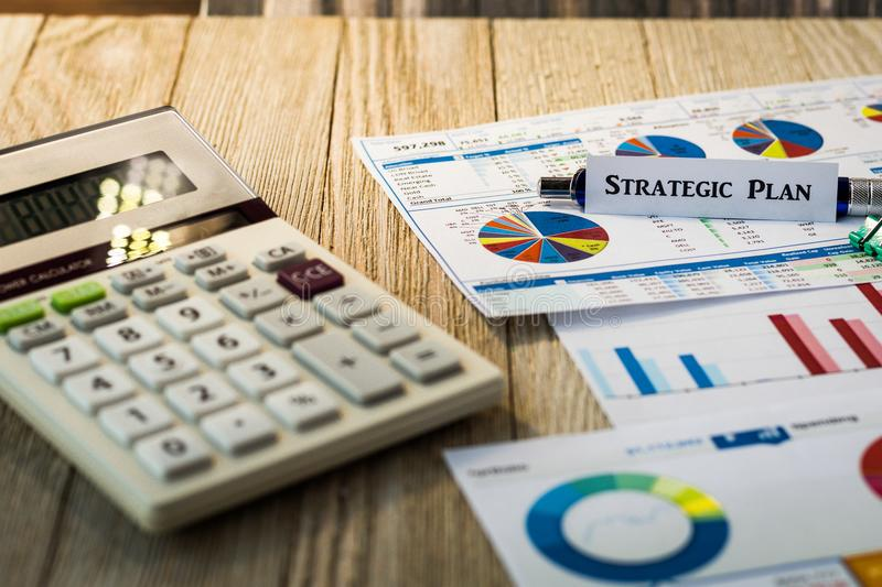 Strategic Plan Investment Performance concept with charts and graphs on wooden board. Investment Strategy motivational finance budget concept with charts and stock photo