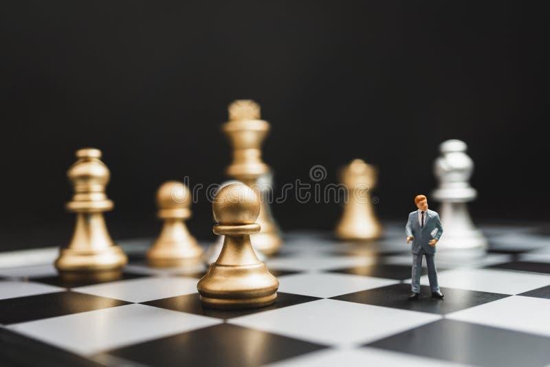 The strategist businessman miniature fixes the problem concept. stock image