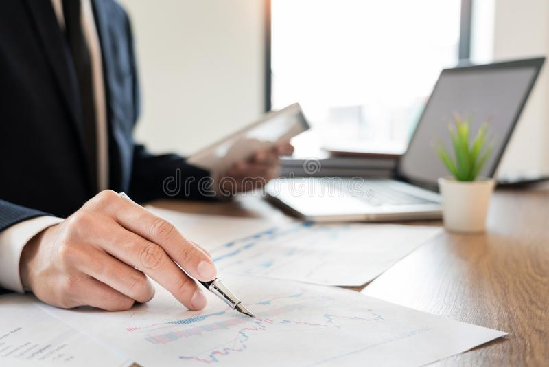 Strategy analysis concept, Businessman working  financial Manager Researching Process accounting calculate analyse market graph. Data stock information review royalty free stock photography