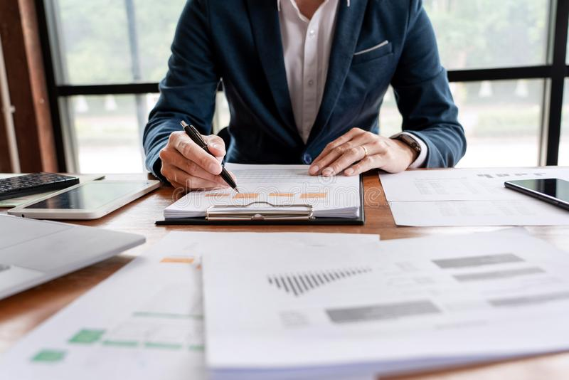 Strategy analysis concept, Businessman working  financial Manager Researching Process accounting calculate analyse market graph royalty free stock photo