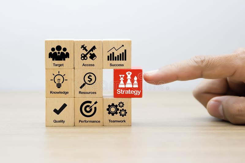 Strategy Business icons on Wood Blocks Concept stock photography