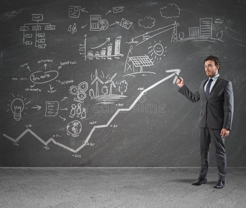 Strategy. Businessman drawing strategy in a blackboard stock photos