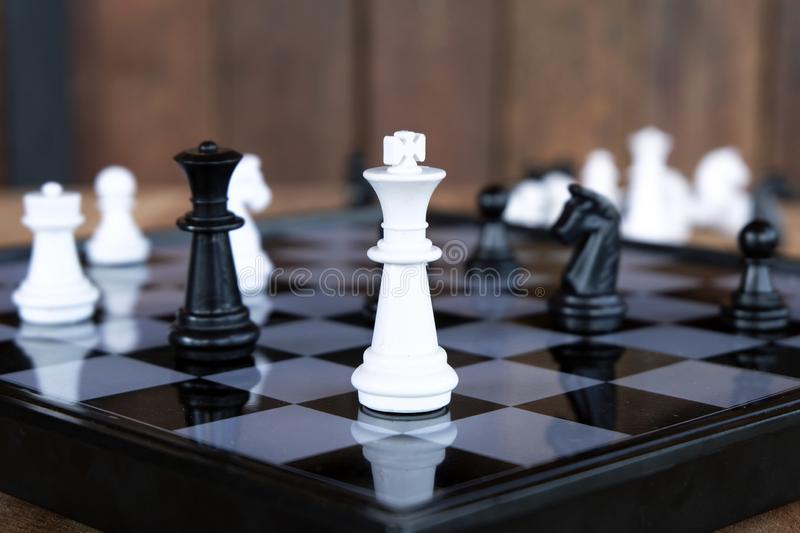 Strategy chess battle Intelligence challenge game on chessboard. stock photography