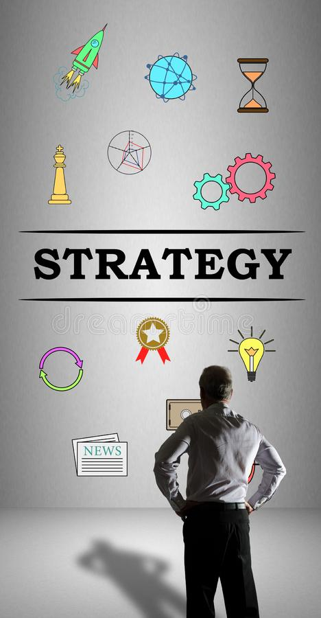 Strategy concept watched by a businessman. Businessman watching a strategy concept drawn on a wall stock images