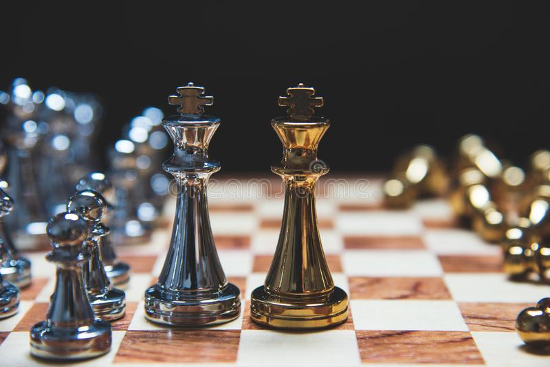 Strategy of leadership as king facing each other in wooden chess board in checkmate position. Business marketing of competition stock images