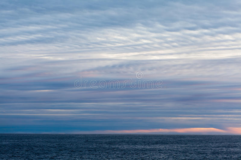Stratus clouds. Over the sea stock images