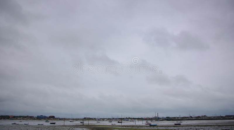 Stratus, Langstone Harbour, UK. A boring grey sky over Langstone Harbour, England royalty free stock image