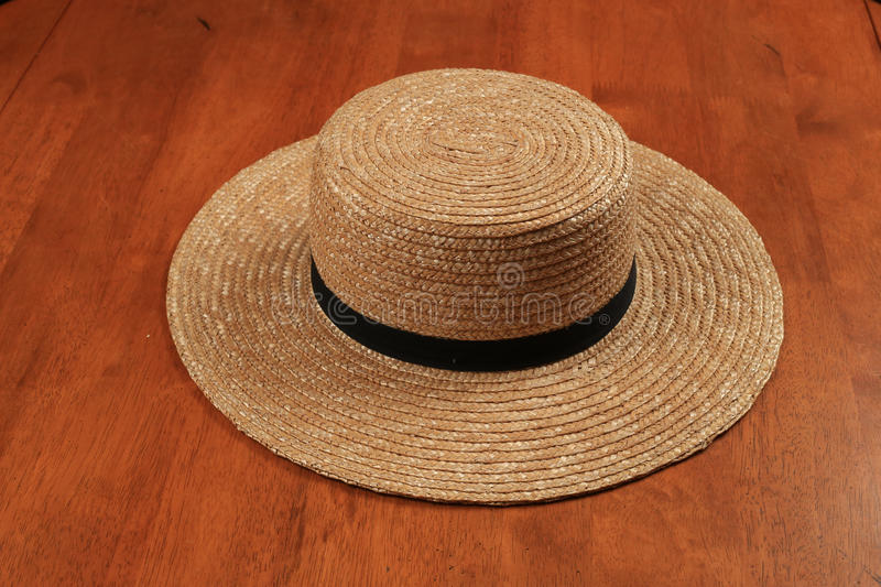Straw Amish Hat. Straw Hat with plain design, wide brim, and a simple black band, worn by Amish farmers royalty free stock photos