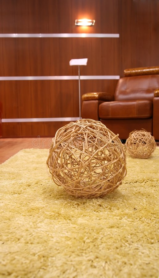 Straw ball on the fur carpet. The straw ball on the fur carpet stock image