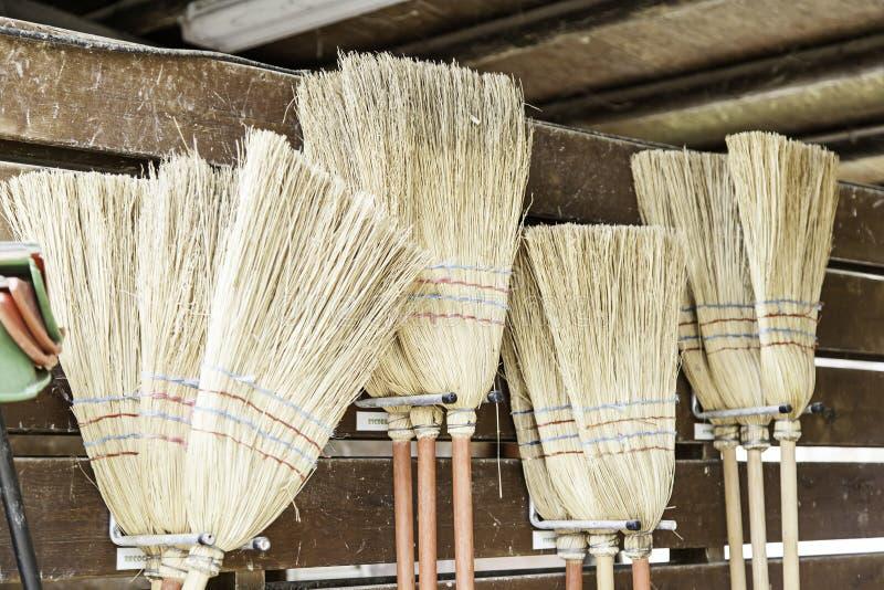 Straw Brooms fotos de archivo