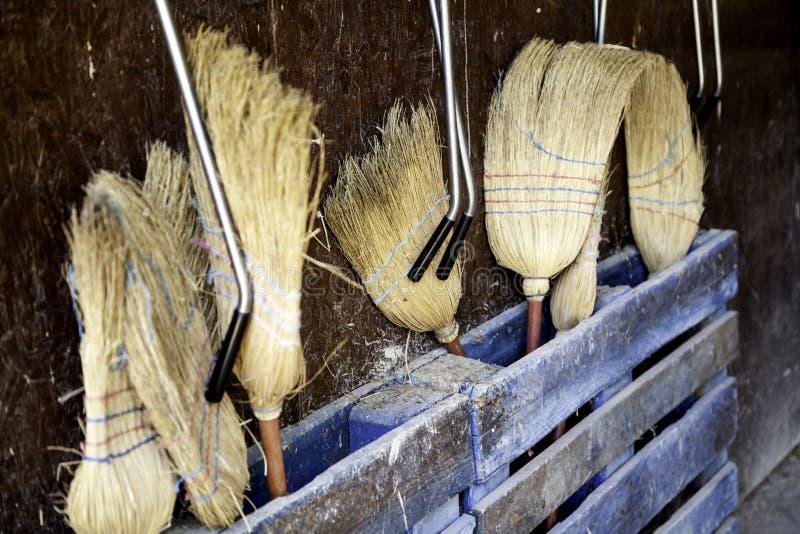 Straw Brooms image stock