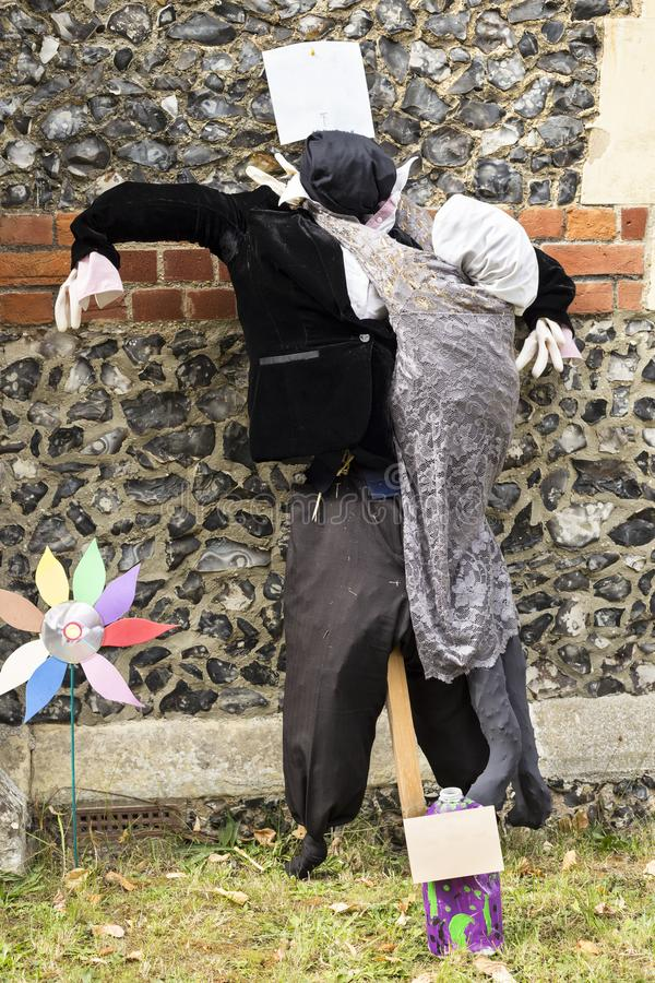 A straw filled caricature figure portraying couple at traditional annual competition in High Wych Scarecrow Festival - Essex, UK stock photography