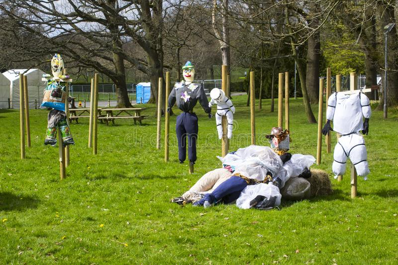 Straw filled Scarecrow type caricature figures for children`s entertainment at the 2018 annual spring festival at Barnett`s Demesn. E Belfast Northern Ireland royalty free stock image