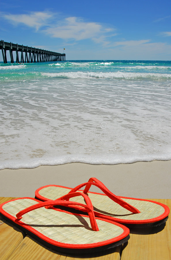 Straw Flip Flops by Pier royalty free stock photo