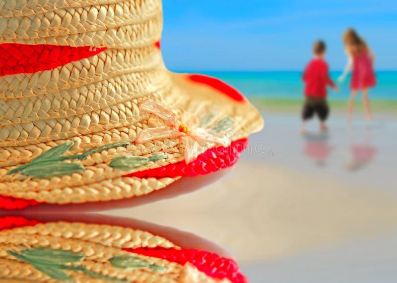 Straw Hat on Beach royalty free stock photos