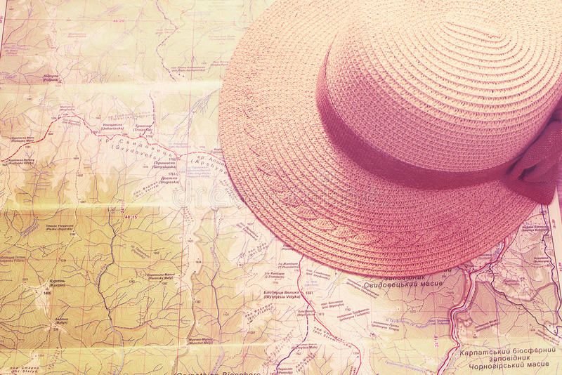 Straw hat, panama on the map. Violet toned image stock image