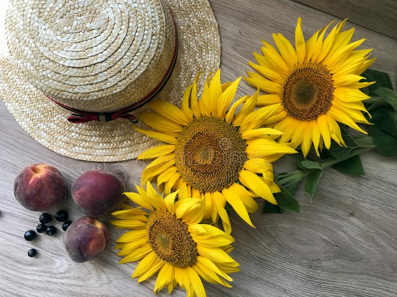 Straw Hat sunflowers on the table royalty free stock photography