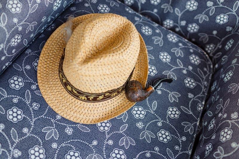Straw Hat and Smoking Pipe stock photo