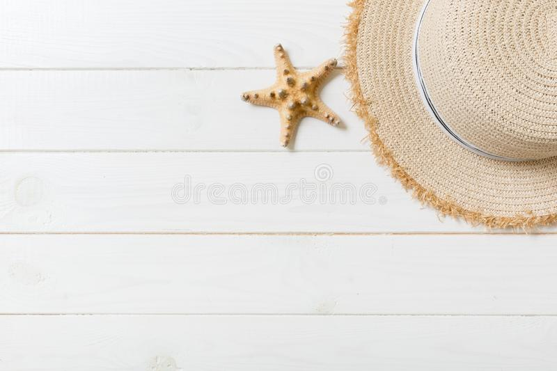 Straw hat and starfish On a white wooden background. top view summer holiday concept with copy space stock photo