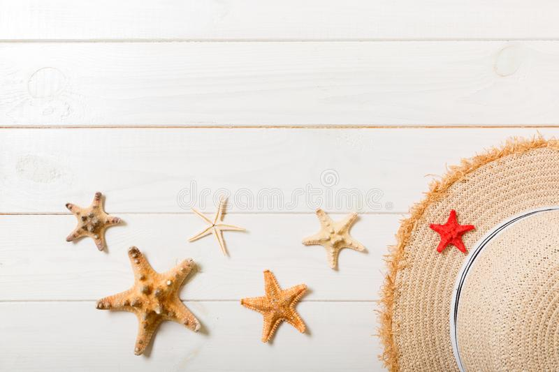 Straw hat and starfish On a white wooden background. top view summer holiday concept with copy space stock photos