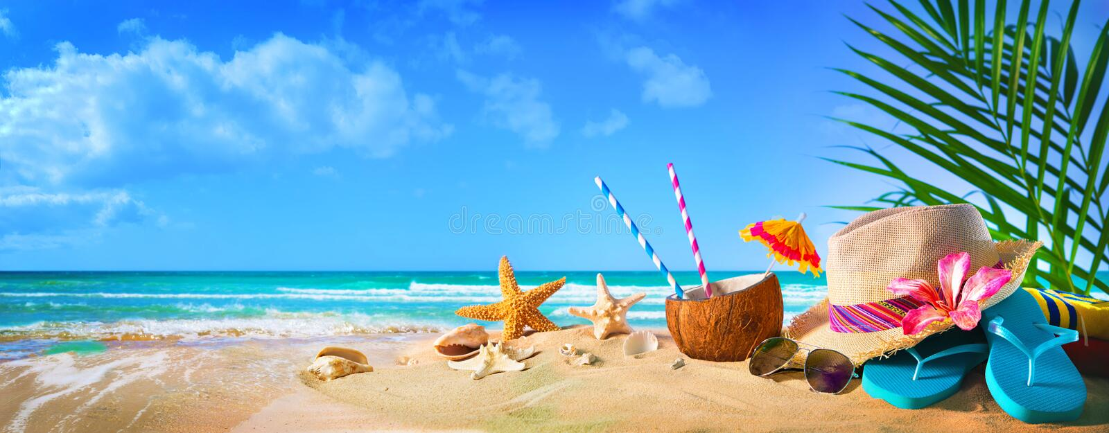 Straw hat and sunglasses on beach royalty free stock photos