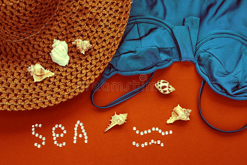 Straw hat and swimsuit stock images