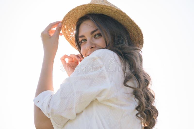 Straw hat woman back. Flirting mood royalty free stock photos