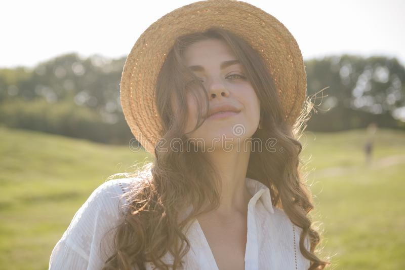 Straw hat woman back. Pretty young face royalty free stock photography